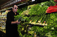 """1/28/13 New Orleans LA.-Actor Dan Aykroyd stops to check out the fresh """"greens"""" at Rouses Supermarket before signing bottles of his Crystal Head Vodka. Aykroyd signs bottles of his Crystal  Head vodka at Rouse's Supermarket prior to Super Bowl XLV11 in New Orleans. Photo©Suzi Altman"""