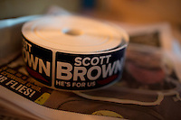 A roll of campaign stickers lays on a surface in the Senator Scott Brown (R-MA) campaign bus between campaign stops in North Billerica and Wakefield, Massachusetts, USA, on Thurs., Nov. 2, 2012. Senator Scott Brown is seeking re-election to the Senate.  His opponent is Elizabeth Warren, a democrat.