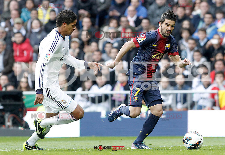 Real Madrid's Raphael Varane (l) and FC Barcelona's David Villa during La Liga match.March 02,2013. (ALTERPHOTOS/Acero) /NortePhoto