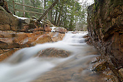 "Franconia Notch State Park - The Baby Flume, which is located just below ""The Basin"" viewing area along the Pemigewasset River in Lincoln, New Hampshire USA during the spring months."