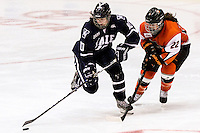 Yale's Jamie Haddad (10) and RIT's Katie Hubert (22) battle for the puck in the third period. RIT defeated Yale 3-0 at Blue Cross Arena in Rochester, New York on October 20, 2012