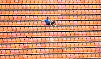 ATENCAO EDITOR IMAGEM EMBARGADA PARA VEICULOS INTERNACIONAIS - SAO PAULO, SP, 16 DEZEMBRO 2012 - TORNEIO CIDADE DE SAO PAULO - PORTUGAL X MEXICO - .Torcedor isolado assiste a partida entre Portugal x México valida pelo Torneio Cidade de São Paulo de Futebol Feminino, no Estádio Paulo Machado de Carvalho (Pacaembu), na região oeste da capital paulista, neste domingo, 16. (FOTO: WILLIAM VOLCOV / BRAZIL PHOTO PRESS).