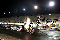 Sep 13, 2013; Charlotte, NC, USA; NHRA top fuel dragster driver Shawn Langdon (near lane) races alongside Billy Torrence during qualifying for the Carolina Nationals at zMax Dragway. Mandatory Credit: Mark J. Rebilas-
