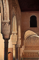 Arched portico in the Court of the Myrtles, or Patio de los Arrayanes, built in the 14th century under Yusuf I, in the Comares Palace, Alhambra Palace, Granada, Andalusia, Southern Spain. The portico rests on columns with cubic capitals and is covered with carved stucco and inscriptions praising God. The Alhambra was begun in the 11th century as a castle, and in the 13th and 14th centuries served as the royal palace of the Nasrid sultans. The huge complex contains the Alcazaba, Nasrid palaces, gardens and Generalife. Picture by Manuel Cohen
