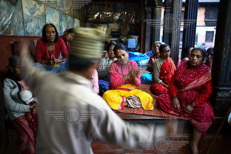 Elderly residents sing in the Pashupati Bridhashram (old peoples' home). Part of the Pashupatinath Temple complex, the old peoples' home is the largest of its type in Kathmandu, home to 140 women and 90 men. Nepal has a steadily growing elderly population.