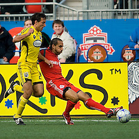 02 May 2009: Columbus Crew defender Jed Zayner #24 and Toronto FC midfielder Dewayne DeRosario #14 in action at BMO Field in a game between the Columbus Crew and Toronto FC. .The game ended in a 1-1 draw...