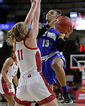 VERMILLION, SD: JANUARY 13:  De'Jour Young #13 of Ft. Wayne drives on Monica Arens #11 of South Dakota during their Summit League game Saturday January 13 at the Sanford Coyote Sports Center in Vermillion, S.D.   (Photo by Dick Carlson/Inertia)