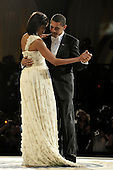 Washington, DC - January 20, 2009 -- United States President Barack Obama and first lady Michelle Obama dance during the Commander in Chief's Ball in downtown Washington, D.C., Tuesday, January 20, 2009.  More than 5,000 men and women in uniform are providing military ceremonial support to the presidential inauguration, a tradition dating back to George Washington's 1789 inauguration. .Credit: James Bowman - DoD via CNP.