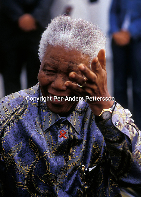 "CAPE TOWN, SOUTH AFRICA - FEBRUARY 11: Former president Nelson Mandela arrives at a ceremony on February 11, 2004 in Cape Town, South Africa. Mr. Mandela attended a ceremony celebrating the first newly built houses in District Six, as colored people were forced away during the sixties to make way for white residents during the Apartheid era. The area is now in the process of being re-constructed and some of the surviving people are soon to move in. Nelson Mandela retired in 1999 and now heads the ""Nelson Mandela Children's Fund"", a foundation supporting projects involving children in South Africa. .(Photo: Per-Anders Pettersson/Getty Images)......."