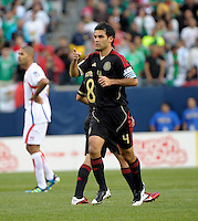 Mexico's Rafael Marquez gives a shot out after scoring Mexico's first goal.  Mexico defeated Costa Rica 4-1 at the 2011 CONCACAF Gold Cup at Soldier Field in Chicago, IL on June 12, 2011.