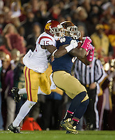 Linebacker Jaylon Smith (9) intercepts a pass intended for USC Trojans wide receiver Nelson Agholor (15) in the third quarter.