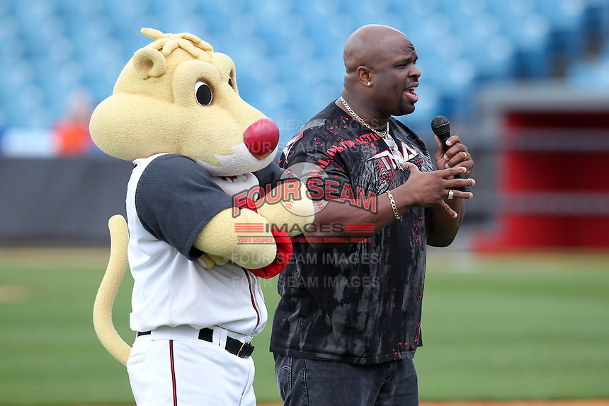"""Nashville Sounds mascot Ozzie with Dudley Boyz wrestler """"Brother Devon"""" (aka Devon E. Hughes) talks with school kids before a game against the Omaha Storm Chasers at Greer Stadium on April 26, 2011 in Nashville, Tennessee.  The game was cancelled due to rain.  Photo By Mike Janes/Four Seam Images"""