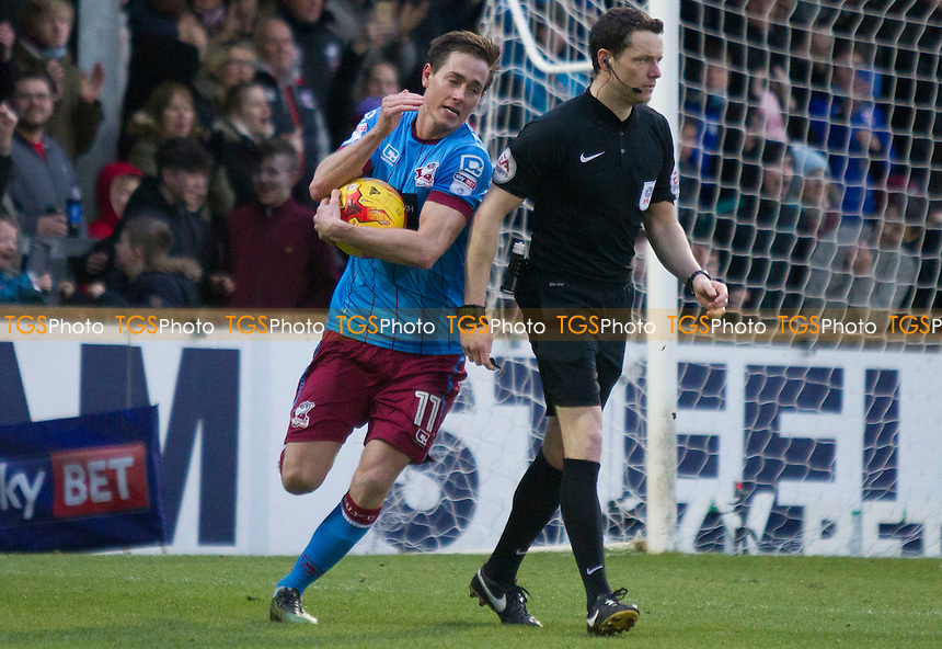 Josh Morris of Scunthorpe picks up the ball after his successful penalty during Scunthorpe United vs Port Vale, Sky Bet EFL League 1 Football at Glanford Park on 28th January 2017