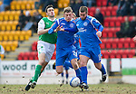 St Johnstone v Hibs....05.03.11 .Peter MacDonald and Murray Davidson battle with Ian Murray.Picture by Graeme Hart..Copyright Perthshire Picture Agency.Tel: 01738 623350  Mobile: 07990 594431