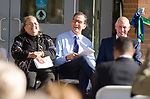 WATERBURY, CT-101317JS11-- Daisy Cocco De Filippis, President of Naugatuck Valley Community College, left,  Gov. Dannel P. Malloy and Mark E. Ojakian, President of the Connecticut State Colleges and Universities, laugh at remarks by Waterbury Mayor Neil M. O'Leary, during the dedication of the Naugatuck Valley Community College's new Center for Hearth Sciences at Founders Hall and the Joseph V. Faryniarz Quadrangle Friday, at the Waterbury campus. <br /> Jim Shannon Republican-American