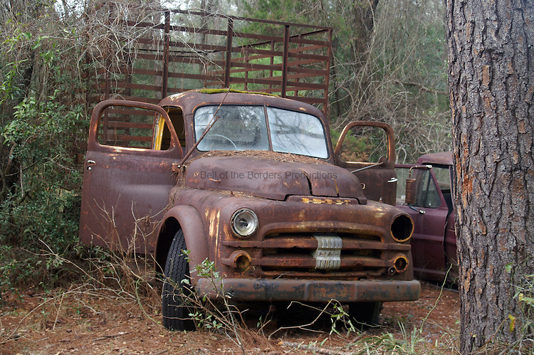 Rusted truck sits and waits.