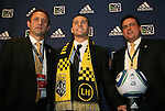 14 January 2010: Dilly Duka was selected with the #8 overall pick by the Columbus Crew. From left: Robert Warzycha, Dilly Duka, Mark McCullers. The 2010 MLS SuperDraft was held in the Ballroom at Pennsylvania Convention Center in Philadelphia, PA during the NSCAA Annual Convention.