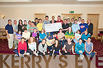 "IO Collective Presentation; Members of the I O Collective, Tralee presenting a cheque for EUR500.00, the proceeds of a raffle held during the ""Feel Good Factor"" shows held in Siamsa Tire in April, to Mark Bulger center second row to who will be representing Ireland at the Special Olyimpics to be held in Poland in September. The presentation was made at Kerins O'Rahilly's GAA club on Tuesday evening last.."