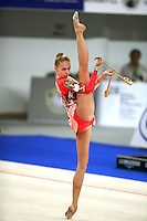 September 21, 2007; Patras, Greece;  Inna Zhukova of Belarus balances with clubs (leg in front) during the All-Around final at 2007 World Championships Patras.  Inna placed 4th in the AA to qualify Belarus for 1st of 2 positions in the individual All-Around competition at Beijing 2008 and the possibility of making her 2nd Olympic Games.  Photo by Tom Theobald. .