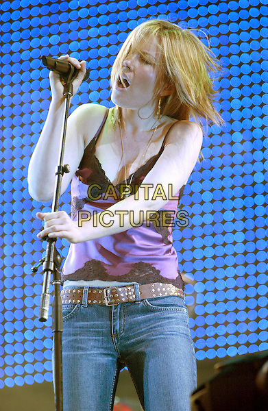 DIDO.First Day Of The V Festival at Hylands Park, Chelmsford..August 21st, 2004.singing, stage, gig, live, music, studded belt, singlet, half length.www.capitalpictures.com.sales@capitalpictures.com.©Capital Pictures