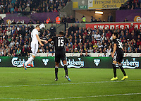 Pictured: Gylfi Sigurdsson of Swansea (L) heads the ball off traget from a team mate's cross over Sylvain Distin (C) and Antolin Alcaraz (R) of Everton. Tuesday 23 September 2014<br /> Re: Capital One Cup, Swansea City FC v Everton at the Liberty Stadium, south Wales, UK