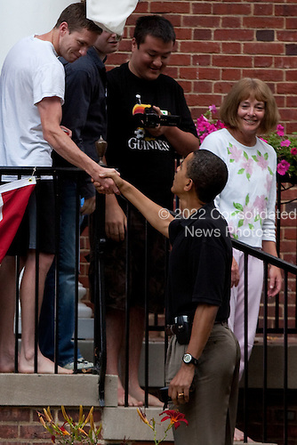 Washington, DC - July 4, 2009 -- United States President Barack Obama greets guests at a home at Ft. McNair upon his return from Camp David on July 4, 2009 in Washington, DC. President Obama will spend the Independence Day holiday at the White House before departing tomorrow for Russia.  .Credit: Brendan Hoffman - Pool via CNP