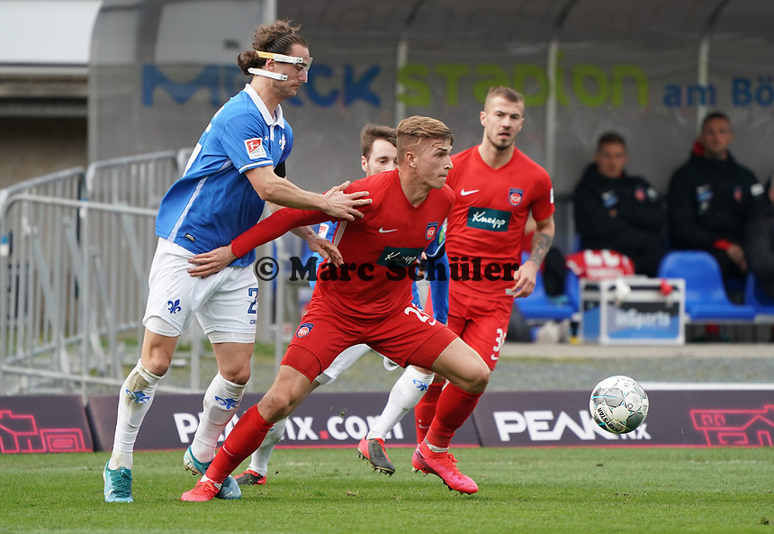 Yannick Stark (SV Darmstadt 98) gegen David Otto (1. FC Heidenheim) - 29.02.2020: SV Darmstadt 98 vs. 1. FC Heidenheim, Stadion am Boellenfalltor, 24. Spieltag 2. Bundesliga<br /> <br /> DISCLAIMER: <br /> DFL regulations prohibit any use of photographs as image sequences and/or quasi-video.
