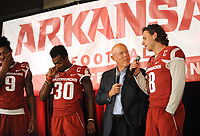 NWA Democrat-Gazette/ANDY SHUPE<br /> Chuck Barrett (center), voice of the Razorbacks, interviews quarterback Austin Allen (right) Friday, Aug. 18, 2017, as defensive backs Santos Ramirez (9) and Kevin Richardson II laugh during the Kickoff Luncheon at the Northwest Arkansas Convention Center in Springdale. Visit nwadg.com/photos to see more photographs from the luncheon.