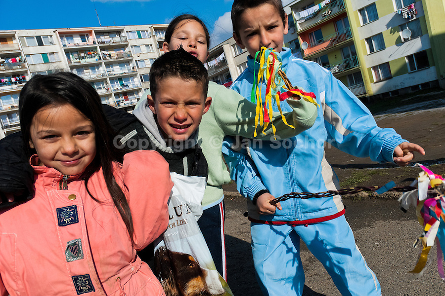 Children, holding their whips made from pussywillow twigs, start the Easter carol in the Gipsy ghetto of Chanov, Most, Czech Republic, 26 March 2008.