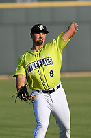 First baseman Chase Chambers (8) of the Columbia Fireflies warms up before a game against the Augusta GreenJackets on Friday, May 31, 2019, at Segra Park in Columbia, South Carolina. Augusta won, 8-6. (Tom Priddy/Four Seam Images)