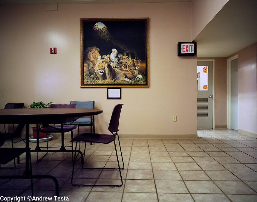 USA. Angola. 12th October 2008..Biblical paintings adorn the walls of the waiting room that joins onto the Death Chamber at Angola. The door on the right (with the jack 'o' lanterns) is the entrance to the Death Chamber..©Andrew Testa/Panos