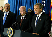 United States President George W. Bush, right, speaks as US Vice President Dick Cheney, center, and US Secretary of State Colin Powell, left, listen after a classified briefing at the Pentagon May 10, 2004.  Bush's trip to the Pentagon was scheduled before the Abu Ghraib prisoner abuse scandal made headlines. <br /> Credit: Mark Wilson / Pool via CNP