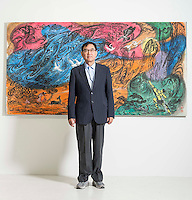 Artist Qiu Deshu poses in front of one of his artworks before the launch of his solo exhibition 'Night and Day': The Art of Qiu Deshu, 1979 and After', at Pearl Lam Galleries on May 28, 2015, in Hong Kong, China. Photo by Victor Fraile / studioEAST