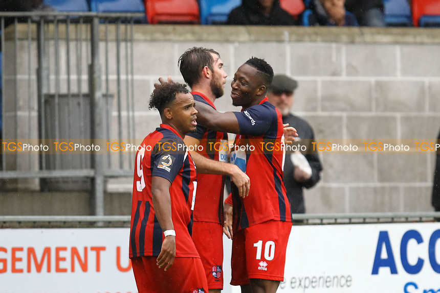 Ricky Willard  (centre) of Hampton & Richmond Borough celebrates his goal in the first half with Matt Whichelow (Left) of Hampton & Richmond Borough and Chris Dickson of Hampton & Richmond Borough during Hampton & Richmond Borough vs AFC Hornchurch, Emirates FA Cup Football at the Beveree Stadium on 6th October 2018