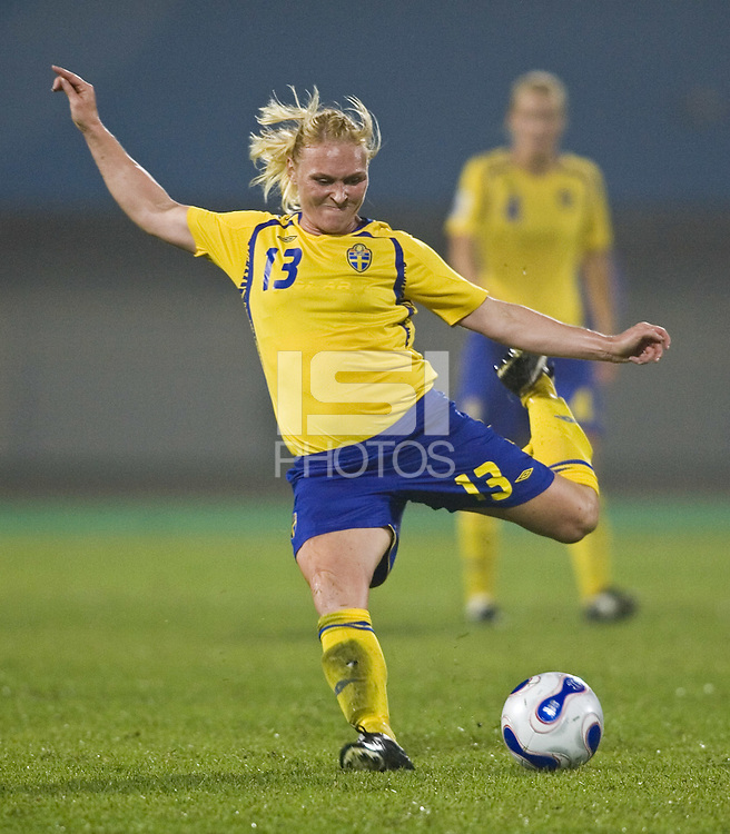 Sweden defender (13) Frida Ostberg. Sweden (SWE) tied Nigeria (NGA) 1-1 during a FIFA Women's World Cup China 2007 opening round Group B match at Chengdu Sports Center Stadium, Chengdu, China, on September 11, 2007.