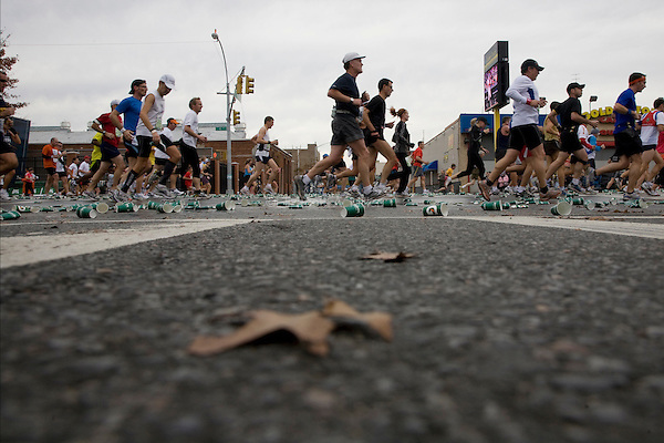Runners passing through a Fluid Station at Mile 7 in the ING New York City Marathon.