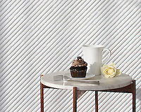 Corduroy, a hand-cut stone mosaic, shown in Venetian honed Thassos and Shell, is part of the Tissé™ collection for New Ravenna.