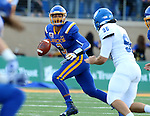BROOKINGS, SD - SEPTEMBER 10:  Taryn Christion #3 from South Dakota State rolls out of the pocket while being pursued by Tanner Evans #96 from Drake during their game at the Dana J. Dykhouse Stadium Saturday night in Brookings. (Photo by Dave Eggen/Inertia)