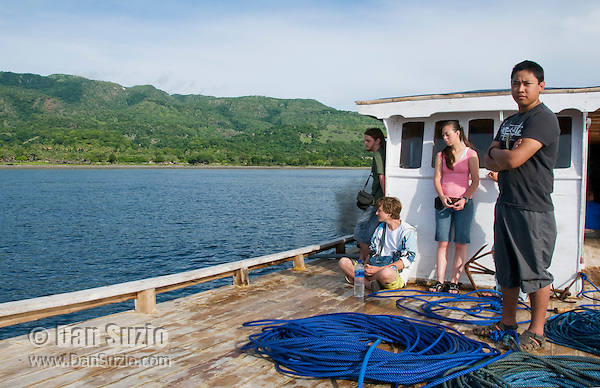 American college students Scott Heacox, Eric Leatham, Caitlin Sanchez, and Jester Ceballos (left to right) on the deck of a small boat leaving the dock at Beloi, Atauro Island, bound for Dili, Timor-Leste (East Timor)
