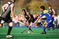NZ's Arun Panchia sends a pass through to Ben Collier during the international hockey match between the New Zealand Black Sticks and Malaysia at Fitzherbert Park, Palmerston North, New Zealand on Sunday, 9 August 2009. Photo: Dave Lintott / lintottphoto.co.nz