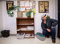 "James Shepherd, of Lincoln Village, Ohio, and his two Conure parrots, ""Boots"" (left) and ""Gladys"", wait to be seen at the Avian Health Clinic on Oct. 27, 2012."