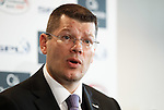 SPL Chief Executive Neil Doncaster takes his seat to face the press at Hampden