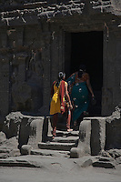 Kailash Temple at Ellora Caves Aurangabad, India.Kailash Temple, also Kailasa Temple is one of the 34 monasteries and temples, extending over more than 2 km, that were dug side by side in the wall of a high basalt cliff in the complex located at Ellora, Maharashtra, India. Of these 34 monasteries and temples, the Kailasa (cave 16) is a remarkable example of Indian rock-cut architecture on account of its striking proportion; elaborate workmanship architectural content and sculptural ornamentation.. It is designed to recall Mount Kailash, the abode of Lord Shiva[2]. While it exhibits typical Dravidian features, it was carved out of one single rock. It was built in the 8th century by the Rashtrakuta king Krishna I..The Kailash Temple is notable for its vertical excavation-carvers started at the top of the original rock, and excavated downward, exhuming the temple out of the existing rock. The traditional methods were rigidly followed by the master architect which could not have been achieved by excavating from the front. The architects found to design this temple were from the southern Pallava kingdom.. Cave 10 in Ajanta Caves contains the oldest Indian paintings of historical period, made around the 1st century BC.<br />