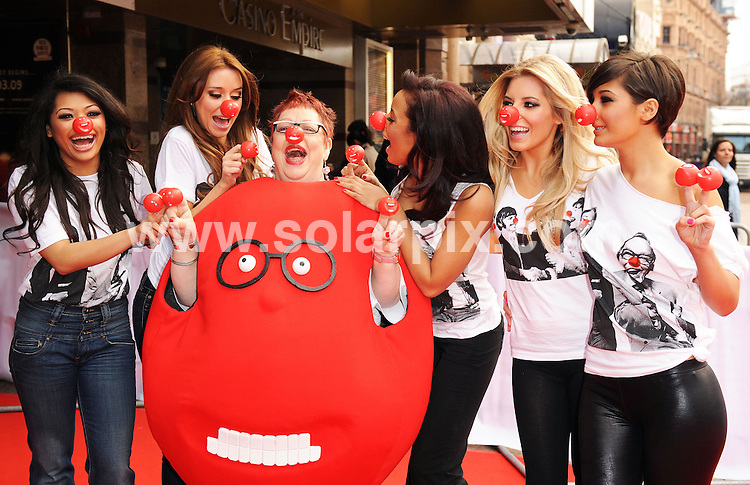 **ALL ROUND PICTURES FROM SOLARPIX.COM**.**WORLDWIDE SYNDICATION RIGHTS**.The Red Nose Day launch for Comic Relief 2009.  Held at The Empire in Leicester Square, London.  .This pic: The Saturdays and Jo Brand..JOB REF:8347-SSD     DATE:28-01-09.**MUST CREDIT SOLARPIX.COM OR DOUBLE FEE WILL BE CHARGED* *ONLINE USAGE FEE £50.00 PER PICTURE - NOTIFICATION OF USAGE TO PHOTO@SOLARPIX.COM*
