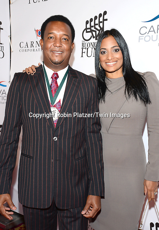 Pedro Martinez and wife Caroline Cruz de Martinez attend The Buoniconti Fund to Cure Paralysis 29th Annual Gala Sport's Legends Dinner on September 29,2014 at the Waldorf Astoria Hotel  in New York City. <br /> <br /> photo by Robin Platzer/Twin Images<br />  <br /> phone number 212-935-0770