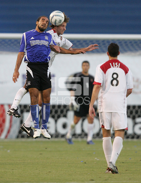 23 July 2005: Dwayne De Rosario of the Earthquakes battles for the ball in the air with the MetroStars defender at Spartan Stadium in San Jose, California.  Earthquakes defeated MetroStars, 2-1.  Credit: Michael Pimentel / ISI