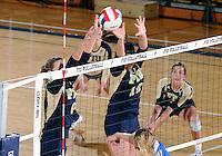 Florida International University women's volleyball player Jessica Egan (6) and Sabrina Gonzalez (12) play against Florida Gulf Coast University.  FIU won the match 3-0 on November 8, 2011 at Miami, Florida. .