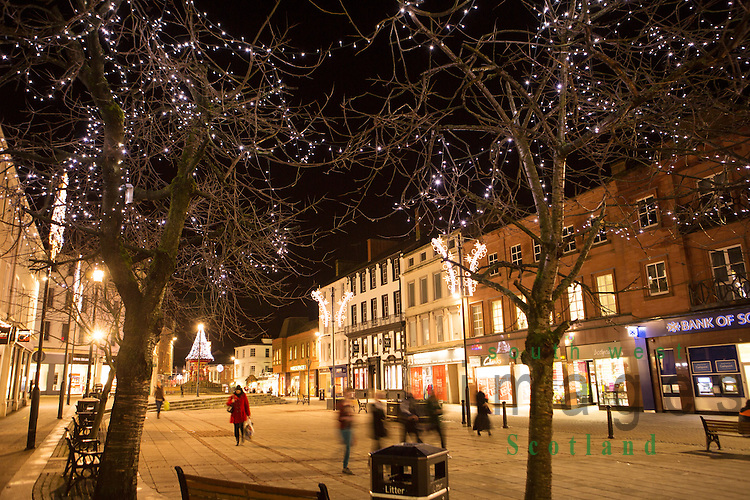 Christmas lights in town centre Queensberry Square Dumfries looking up to fountain