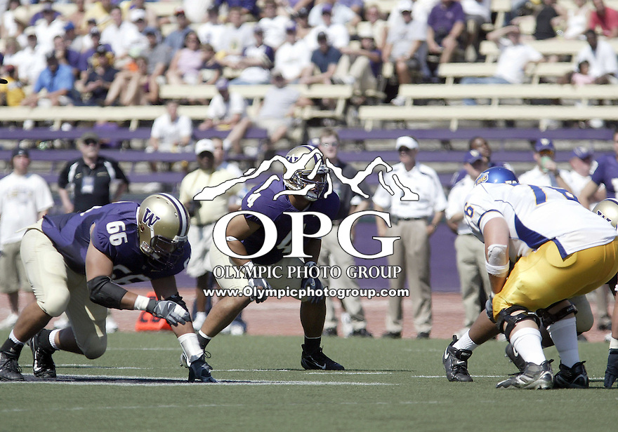 SEPT 02, 2006: Washington Huskies defensive players Daniel Te'o-Nesheim and Scott White get set against the San Jose State Spartans at Husky stadium in Seattle, WA.