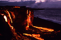 lava flowing over the sea cliff to the black sand beach below, Kohola ocean entry, Hawaii, USA Volcanoes National Park, Big Island of Hawaii, USA, Pacific Ocean